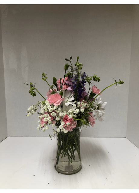 Delicate vase of Spray Roses and Larkspur