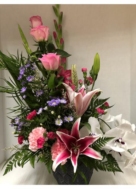 Stargazer Lilies, Phalaenopsis, Roses and Gladiolus